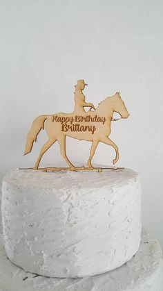 Happy Birthday + Name Cowgirl With Horse Topper Laser Cut Design and Customized by CustomLaserWurx  Laser cut from 1/8 wood.  We only offer this cake topper in a raw finish for rustic look, you can however paint it to whatever color you want!  To expedite process.. please provide name