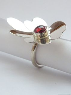 Sterling silver Garnet flower ring by MonumentsToCulture on Etsy