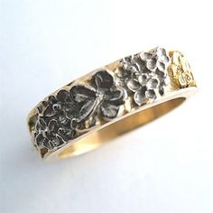 as close as I can find online to my bespoke engraved hibiscus wedding ring. this one is also beautiful.     Hibiscus Custom Ring 18k by RXVrings on Etsy, $1050.00