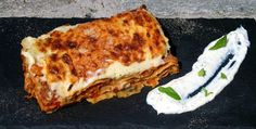 Lasagna with vegetables and minced meat, cinamon and cloves with cold feta cheese sauce flavored with mint Paparouna Wine Restaurant & Cocktail Bar Greek Recipes, Wine Recipes, Tasty Meatballs, Mince Meat, Best Meat, Cheese Sauce, Lasagna, Feta, Kitchens