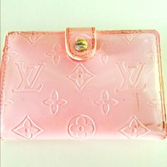 Vintage pink Louis Vuitton wallet Boughten at a estate sale! It's certified authentic Louis Vuitton Boughten and from  Paris , France It's an adorable light pink color I show the note of authenticity in the pictures minor little scratches on the bottom right needs someone who will appreciate it throughly please don't be afraid to offer a price / favorite , like and ask questions :)  Message me for my pictures but only if your serious about buying Louis Vuitton Bags Wallets