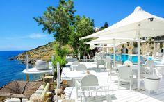 Kivotos Le Pirate Pool Side Restaurant overlooking Ornos bay in Mykonos  www.kivotosmykonos.com