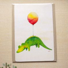 4'' x 6'' inch print of a cute green alligator flying up into the air. Original illustration was drawn with colored pencils and watercolor, then scanned & digitally edited.  Cardboard backing is placed behind the print to protect from bending during shipping.  Actual color of the product may ...