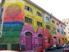 Italian Street Artist BLU Covers Two Sides of a Warehouse in Rome With Colorful Faces