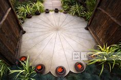Never seen anything like this lotus-inspired patio. Love the accents of color around the edges. Designed by Lenkin Design.