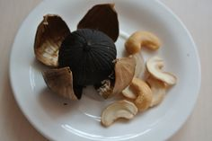Aged Black Garlic is a black coloured garlic with low odour and provides Caruso's Aged Garlic with its numerous health promoting benefits. Find out more about Caruso's Aged Garlic at www.carusosnaturalhealth.com.au/aged-black-garlic Black Garlic, Best Appetizers, Tapas, Cocoa, Stuffed Mushrooms, Beans, Snacks, Canning, Dinner