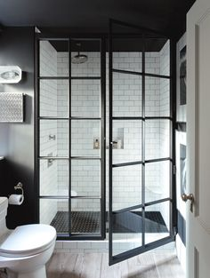 Jenny Wolf Devonshire House - Consider glass doors Wolf removed the tub and curtain in this bathroom. A shower with an industrial-style steel casement enclosure replaced the bath, adding three feet of functional space. Glass showers make the room feel bigger, notes Wolf, whereas shower curtains cut off the room. | Architectural Digest