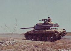 An M-41 Walker Bulldog tank from the 5th ARVN Cavalry opens fire on an enemy position in Bien Hoa (III Corps).    Photo taken: February 1969