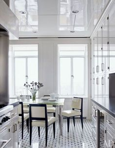 In a New York kitchen, chairs by Dominique upholstered in patent leather s. In a New York kitchen, chairs by Dominique upholstered in patent leather surround a custom-made glass-top table by the home& decorator, Delphine Krakoff. Architectural Digest, Kitchen Interior, Interior And Exterior, Kitchen Design, Interior Design, Kitchen Tile, Kitchen Floor, Kitchen Chairs, Apartment Kitchen