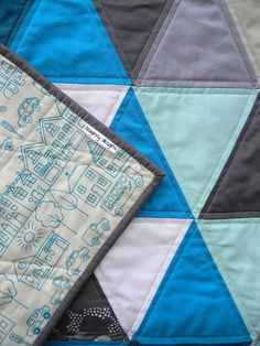 love the mostly solids with one or 2 very unique patterns, and the supercool backing.