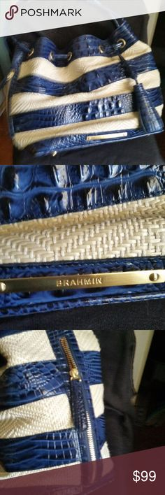 Brahmin Lexi Iris Corsica Navy Drawstring Purse This is a gorgeous pre owned bag that shows almost no wear.  Perfect Condition.  Navy Blue leather with straw type inserts.  Has 2 zippered compartments, one on each side. Please contact me with questions!   Thanks for looking! Brahmin Bags Crossbody Bags