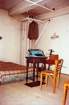 """Burroughs """"The Bunker,"""" his apartment in a converted YMCA 222 Bowery, NYC. A good reminder for any of those times when one is procrastinating. All too often people convince  themselves (certainly, I do this) they need better tools, more inspiring environments, et cetera, in order to create."""