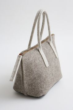 5th prototype of a lunch bag, acrylic medium applied inside the bag by Aika Felt Wors