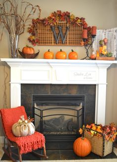 Colorful fall mantel with lots of orange and brown and pumpkins.  Love the way the antique printer's box is decorated with fall leaves.