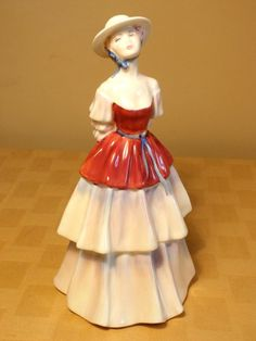 ROYAL DOULTON  ELIZA figurine 3179. Delicate features and tiered dress. Enjoying a lovely afternoon #RoyalDoulton