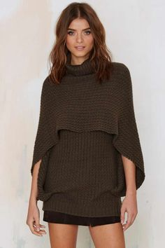 The So Over It Sweater is made in a super soft olive green knit and features layered design, cape silhouette, and turtle neck.