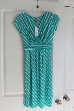 I love the color of this (& stripes)...not sure how it would look on me but I would try it on if I saw it in the store I think.
