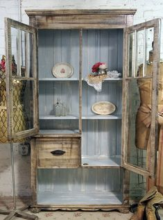 This made to order handmade cabinet is made right in our studio using architectural finds, reclaimed wood and solid pine. Perfect for your cottage kitchen, bath, dining room or living room. Makes a great bookcase, china cabinet or linen cupboard. FEATURES: Handmade glass doors. Made