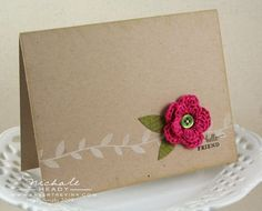 Nicole has a tutorial (with photos) for the crocheted flower pictured on the this card.