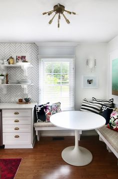 Adding banquet seating and a round tulip table makes it possible to have a breakfast nook in cramped kitche...