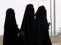 À espera da vida: Mulher árabe...