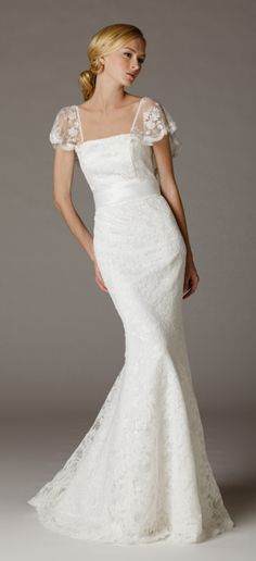Butterfly sleeves trumpet wedding dress in Ivory lace. This gown features beaded flutter sleeves that extends to low-back. Made in USA.