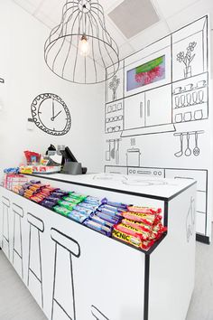 "Beautiful idea and execution: The Candy Room looks exactly like a candy room would in your dreams. No actual heavy-duty furniture, childlike artwork all over the place, and pretty much everything in black and white but the actual candy itself. ""Edgy, humorous, and uniquely charismatic. It was not to be simply a shop; it had to be a destination and an experience,"" was the brief for the design given to Red Design Group, the creative minds behind the design of the new Melbourne shop."