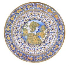 A Cantagalli maiolica Renaissance-style charger, decorated in the Deruta style in shades of blue