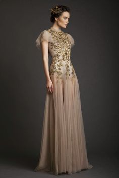 Attention all high fashion brides!  Your couture wedding dress dreams are about to come true. We are swooning over Krikor Jabotian's Spring/Summer 2014 bridal collection. Jabotian's newest line is all about texture: flower appliqués, beading, feather accents, sequins, and lace. Each dress is breathtaking, and his designs are as equally beautiful and intricate from the back as read more...
