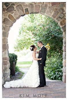 Love the use of the stone archway and the nature for the background.  Very pretty.