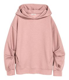 Powder pink. Oversized sweatshirt with a lined hood, heavily dropped shoulders and diagonal side pockets. Long sleeves with box pleats and ribbing at cuffs