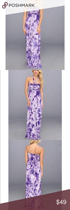 Purple Tye Dye Maxi Dress Passersby at your favorite seaside haunt will do double-takes to confirm whether the vision in a flowing dress was a figment of their imaginations, or a living, breathing goddess. Size: Xs Color: Purple  Strapless maxi dress features flattering gathered details at bodice with knotted center and cascading ties. Empire waist with pleating for an elongated look. Smocking at back of bodice. Straight, floor-length hem. 95% rayon, 5% spandex. Measurements: Length: 54 in…