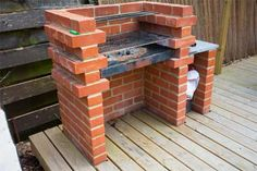 Brick bbq with table and warming rack