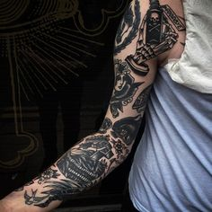Get a traditional flash art sleeve. | 49 Bloody Brilliant Black And Grey Tattoo Ideas