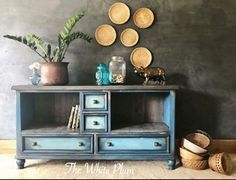 Repurposed dresser into media stand by The White Plum | Painted with a mix of Chalk Paint® by Annie Sloan in Napoleonic Blue, Provence and Antibes Green | Paint Sell Repeat feature