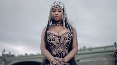 "Nicki Minaj Gives Queen Elizabeth Some Royal Competition in ""No Frauds"" Video"