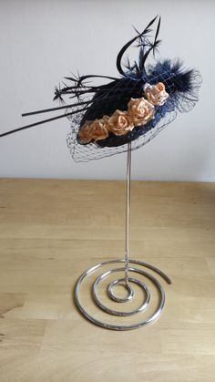 Check out this item in my Etsy shop https://www.etsy.com/uk/listing/269836663/blackorange-fascinator-hat-for-weddings