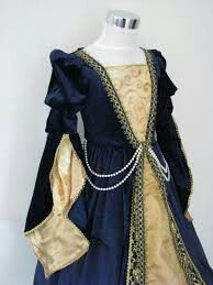 Medieval dress.  Like the pearls