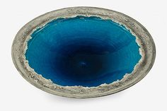 Len Castle Crater Lake bowl with alkaline blue glaze to the well and textured sculptured cavetto. D. 500mm