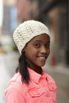 This hat is knitted in the round with a lace and cable pattern.  Perfect for those who like a minimalist, but feminine look.