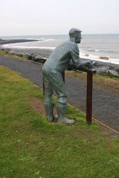 Statue of a man looking out to sea at Port William - Port William is a small fishing village in the area of Mochrum, Wigtownshire, Dumfries and Galloway, in south-west Scotland