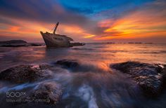Wreck boat in sunset