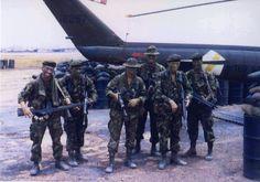 1968 Vietnam War - Long-range reconnaissance patrol (LRRPs) team at Bien Hoa Air Force Base waiting to be flown to the field.
