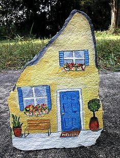 Handpainted rock house doorstop
