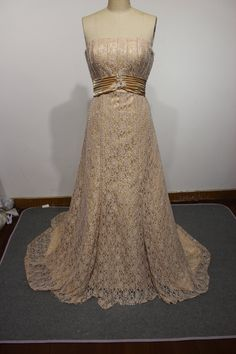 dark champagne beaded strapless A line lace wedding dress corset back. $245.00, via Etsy.