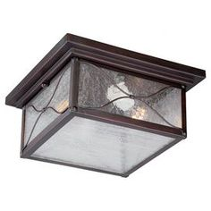 "Cast a warm glow over your patio or garden walk with this classic bronze-finished flush mount, showcasing seeded glass panels with cinched metal wire overlay.  Product: Flush mountConstruction Material: Metal and glassColor: Classic bronzeFeatures: Suitable for indoor or outdoor useAccommodates: (2) 60 Watt bulbs - not includedDimensions: 7.7"" H x 13.78"" W x 13.78"" D"