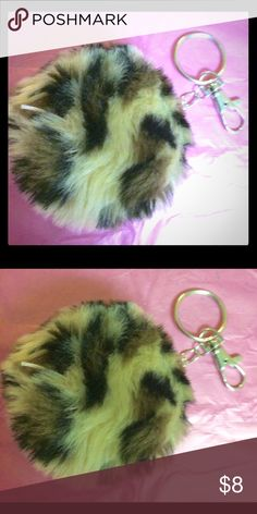 Leopard print Pom Pom Keychain This poofy Pom Pom also has a carabiner clip to hook onto your bag, as well as a Keychain. Accessories Key & Card Holders