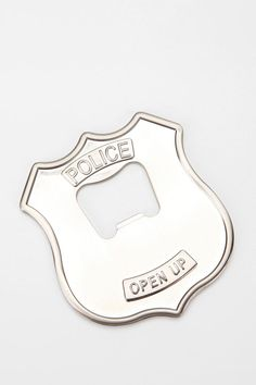 the hilarity of this nick back is directly proportionate to how many alcoholic beverages it opens.  UrbanOutfitters.com > Police Badge Bottle Opener