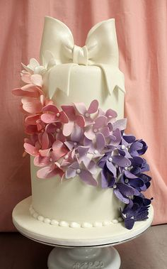 Colorful Flower Cascade Bow Wedding Cake Med by Amanda Oakleaf Cakes, via Flickr pretty gradient flowers pink to purple tumble down sides of cake