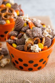 Halloween Party Mix completely with reese's, candy corn, pretzels, popcorn and m&ms